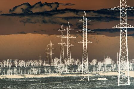 inversion: electric poles in nature in inversion Stock Photo