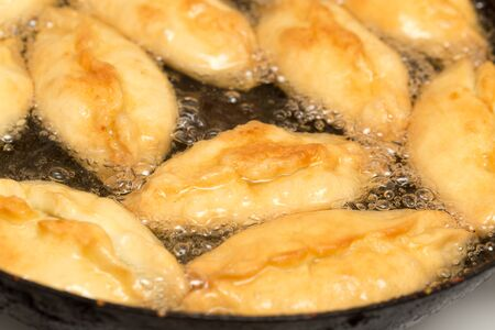 patties are fried in a pan