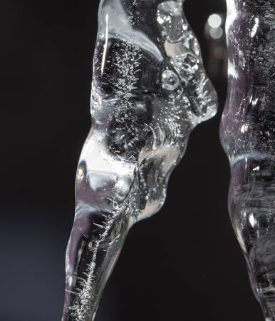 sopel lodu: icicle on a black background