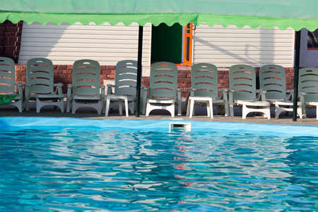inground: Outdoor pool with blue water Stock Photo