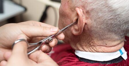 haircutting: Mens haircut with scissors Stock Photo