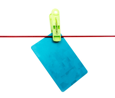 Plastic card on a rope on a white background Stock Photo