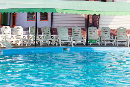 inground: The smooth water in the pool as a background . Stock Photo