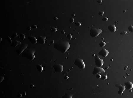 Water droplets on a black background Stock Photo