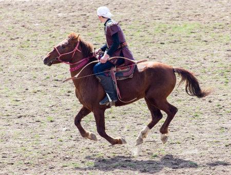 Shymkent, KAZAKHSTAN - 22 March 2017: Celebration of the Kazakh holiday NARIYZ. Competitions on horses Editorial