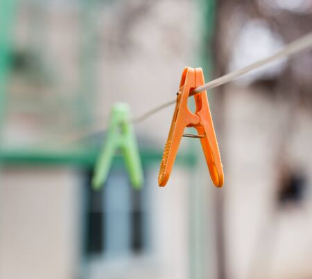 A Colorful clothespins on the clothesline outdoors . Stock Photo
