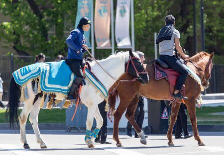 Shymkent, KAZAKHSTAN - May 1, 2017: A man on horseback at the Day of Unity of the People of Kazakhstan .