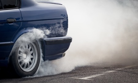 Smoke from under the wheels of the car . Stock Photo - 78136840