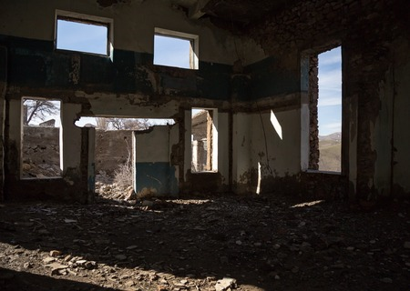 The walls of an old abandoned building from the inside Stock Photo