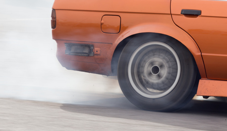 dragster: Smoke from under the wheels of the car .