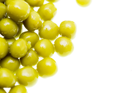 Pickled green peas isolated on white background .