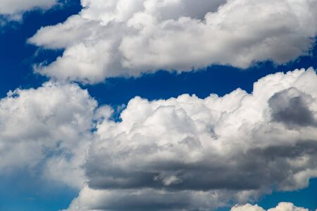 Beautiful clouds against blue sky as background .