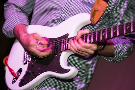 band bar: Musician playing guitar in a rock band . Stock Photo