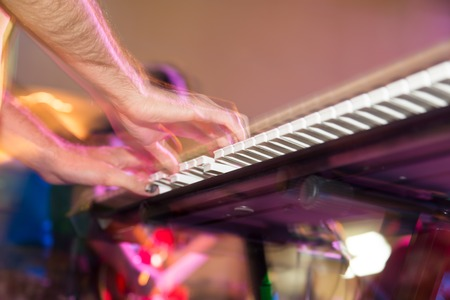 midi: Musician plays keyboards in a rock band .