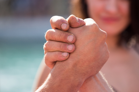 Two mens hands in comparison strength . Stock Photo