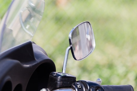 motobike: Chromed mirror on motobike as a detail