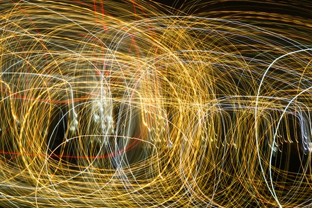 Abstract background of light bulbs at night in motion . Фото со стока