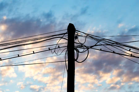 torres eléctricas: Electric wires at sunset as an abstract background