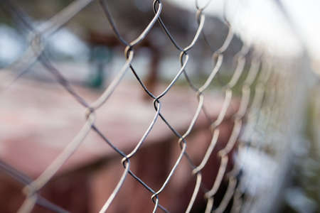 Metal mesh on the fence as a background .