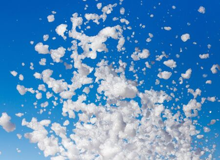 White foam against the blue sky as background Stock Photo