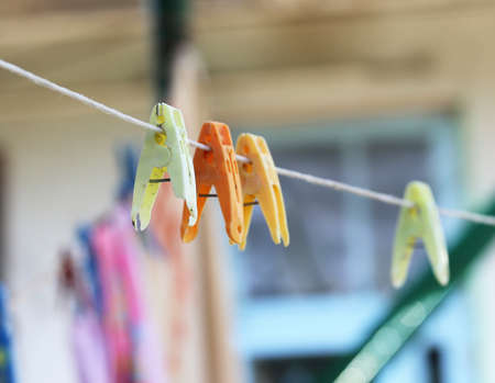 distinct: clothespins on a rope. macro