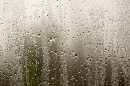 misted glass on the window as a background