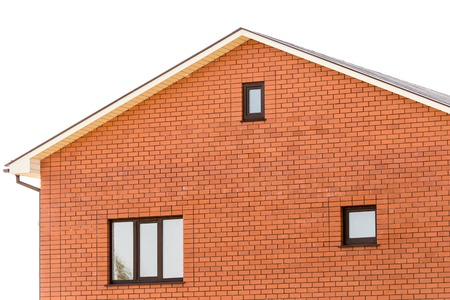 roof with a window in a brick house Stock Photo