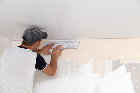 the worker plastered the mortar on the wall