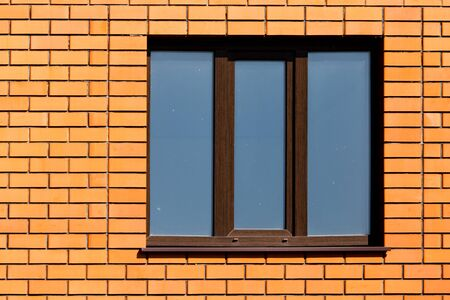 windows frame: window in a brick wall in the house .