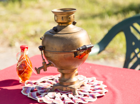desk: Russian samovar on a table in the open air