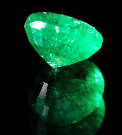 green gem on a black background. macro