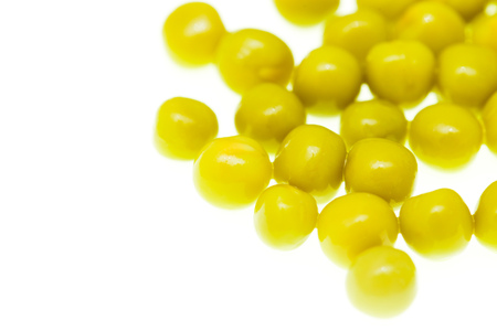 Marinated green peas on a white background .