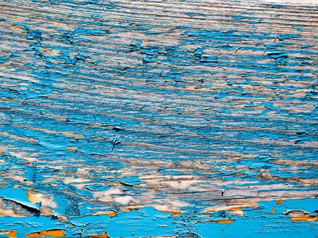 old wooden background painted in blue paint .