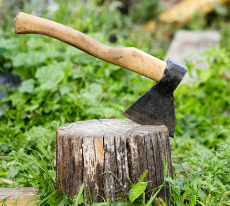 ax thrust in a log in the open air . Stock Photo