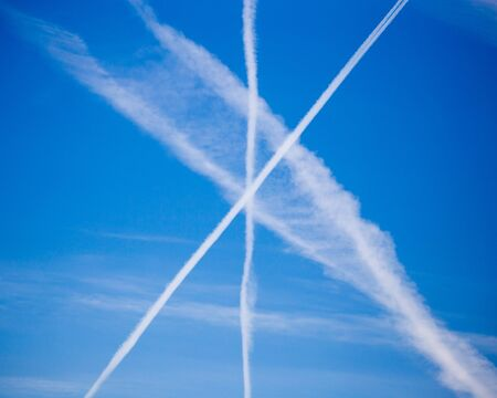 traces of an airplane on a blue sky . Stock Photo