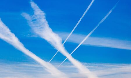 jet stream: traces of an airplane on a blue sky . Foto de archivo