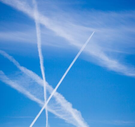 traces of an airplane on a blue sky . Stock fotó