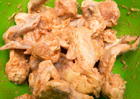 Marinated chicken wings for frying in the oven . Stock Photo