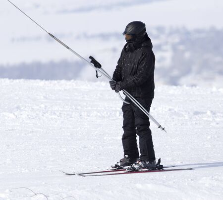 Man skiing in the snow in winter .