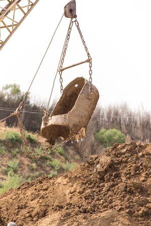 Excavator digging a big bucket Stock Photo