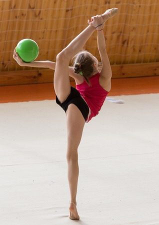 girl with a ball on a professional gymnast .