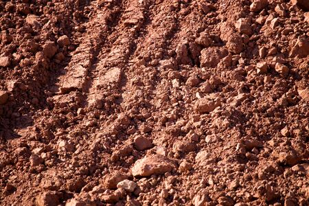 Red clay soil on nature as a background .