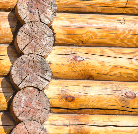 Wall of a house with a log frame as a background . Stockfoto