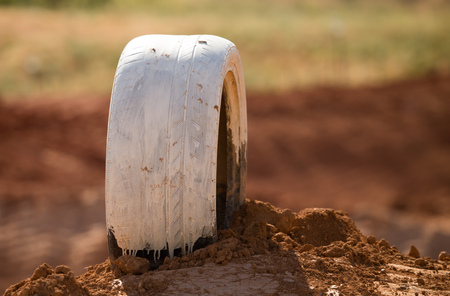 Tires on a red clay track for motorcycles . Stock Photo