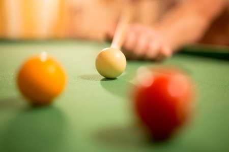 Board game with balls and cue billiards .