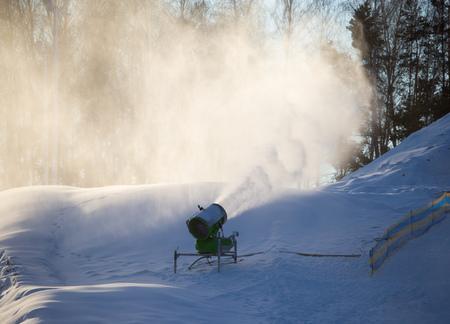 Snow cannon in a ski resort in winter .
