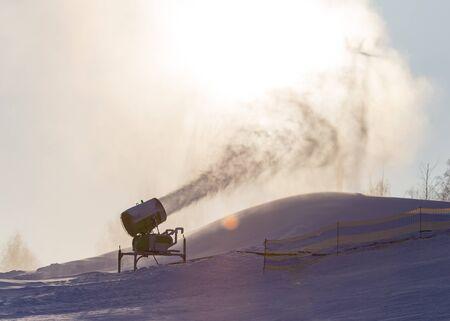 Snow cannon in a ski resort in winter