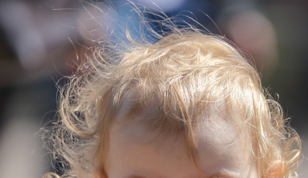 Hair blond on the head of a little boy .