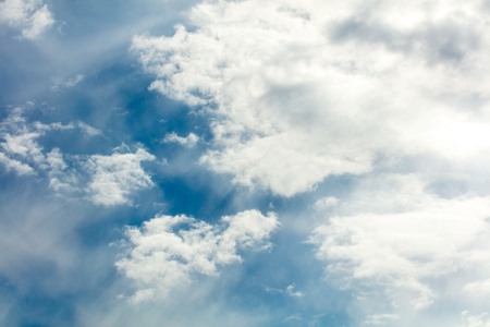 Clouds on a blue sky as a background .