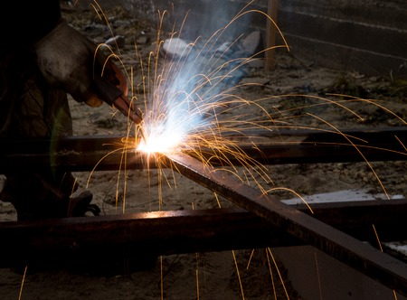 Flash and sparks from electric welding as a background Stock Photo